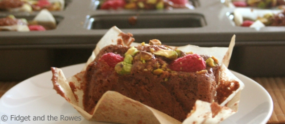 chocolate financiers with raspberries and pistachios